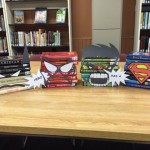 Our book superheroes remind kids to sign up for the reading challenge.