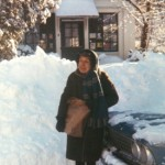 Woman in front of library in winter.